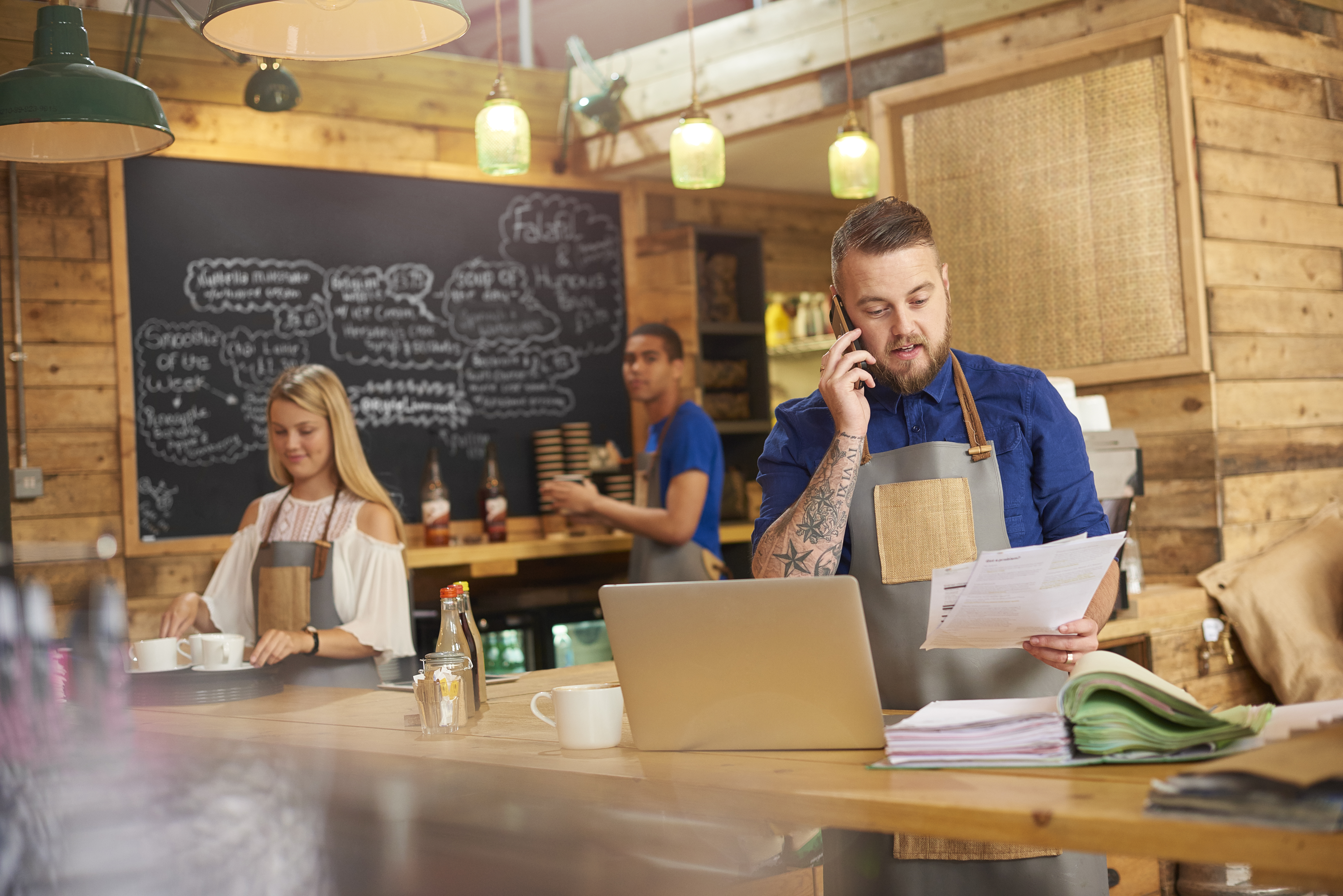 Coffee-shop-owner-phoning-accountant-597272594_7360x4912-1
