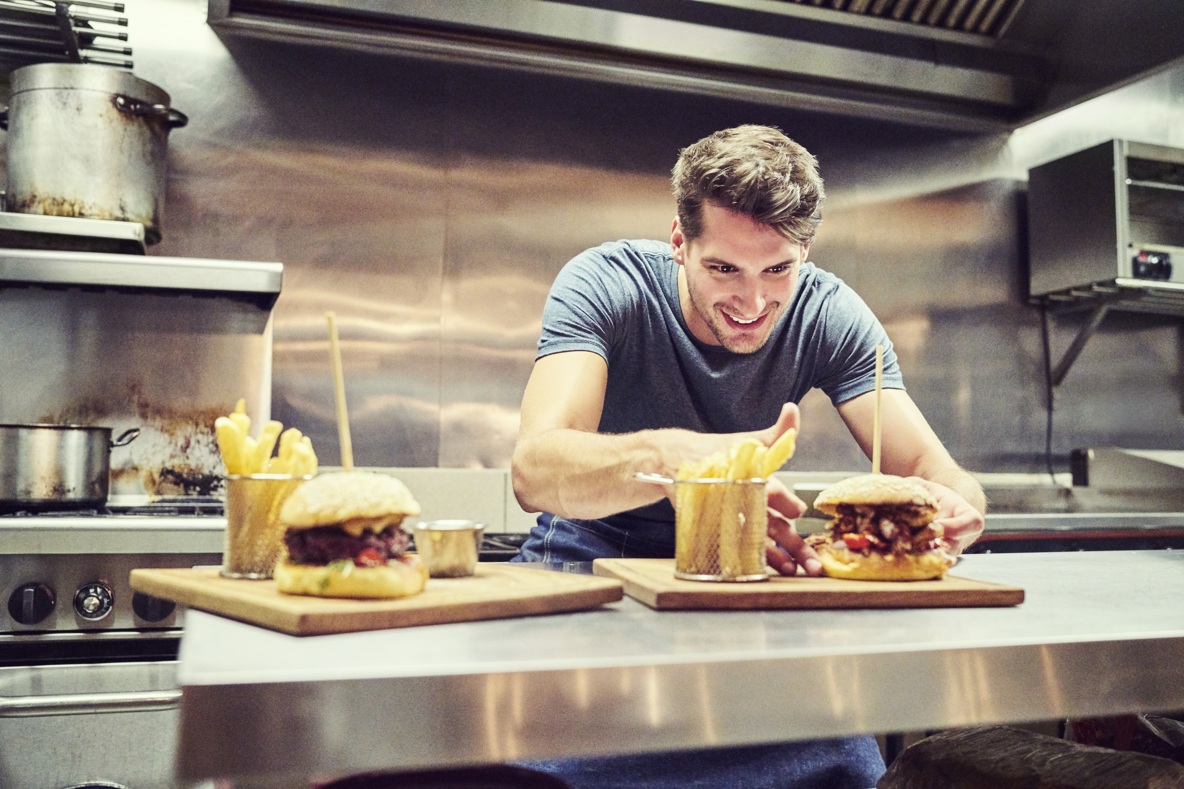 Happy-chef-arranging-burger-and-French-fries-641732094_3867x2579 (1)-1
